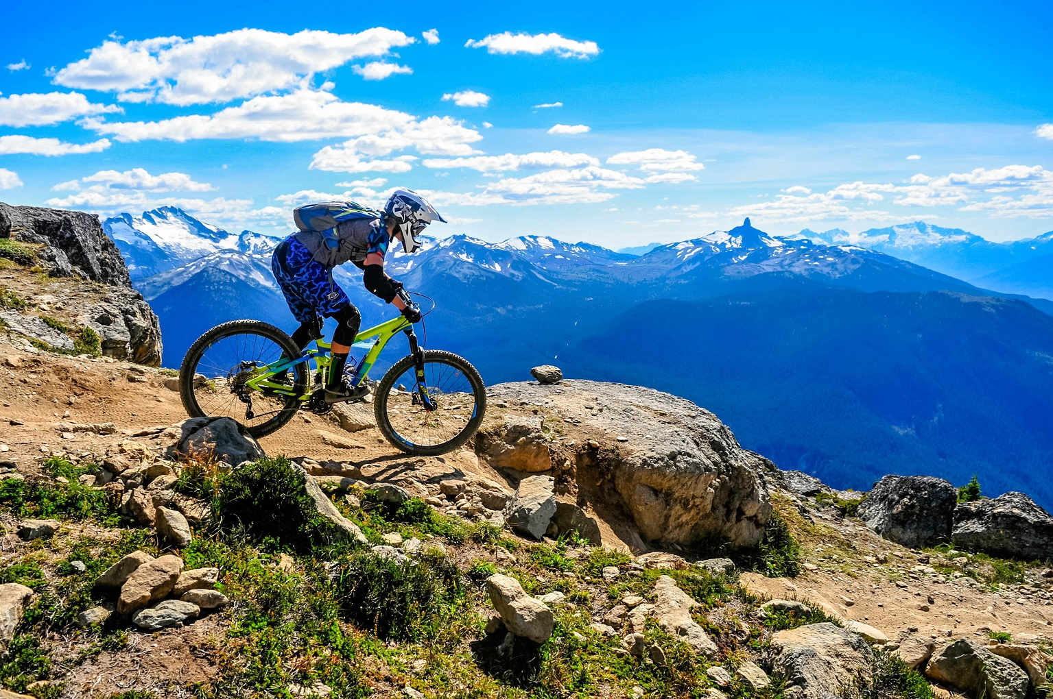 mountain biker in mountain biking gear on mountain bike in mountains blairmore hotels