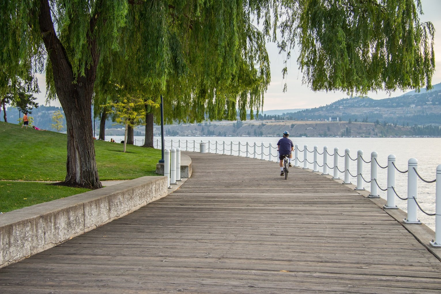 Okanagan hotel man cycling across the bridge