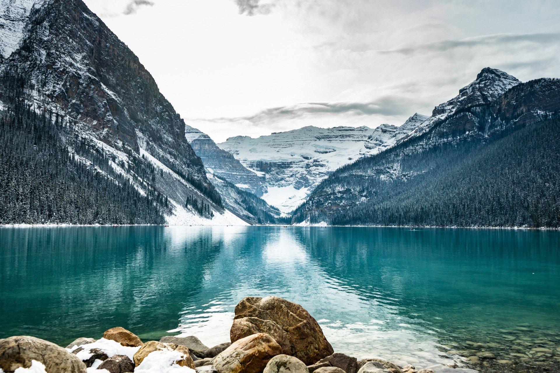 lake below snowy rocky mountains near invermere