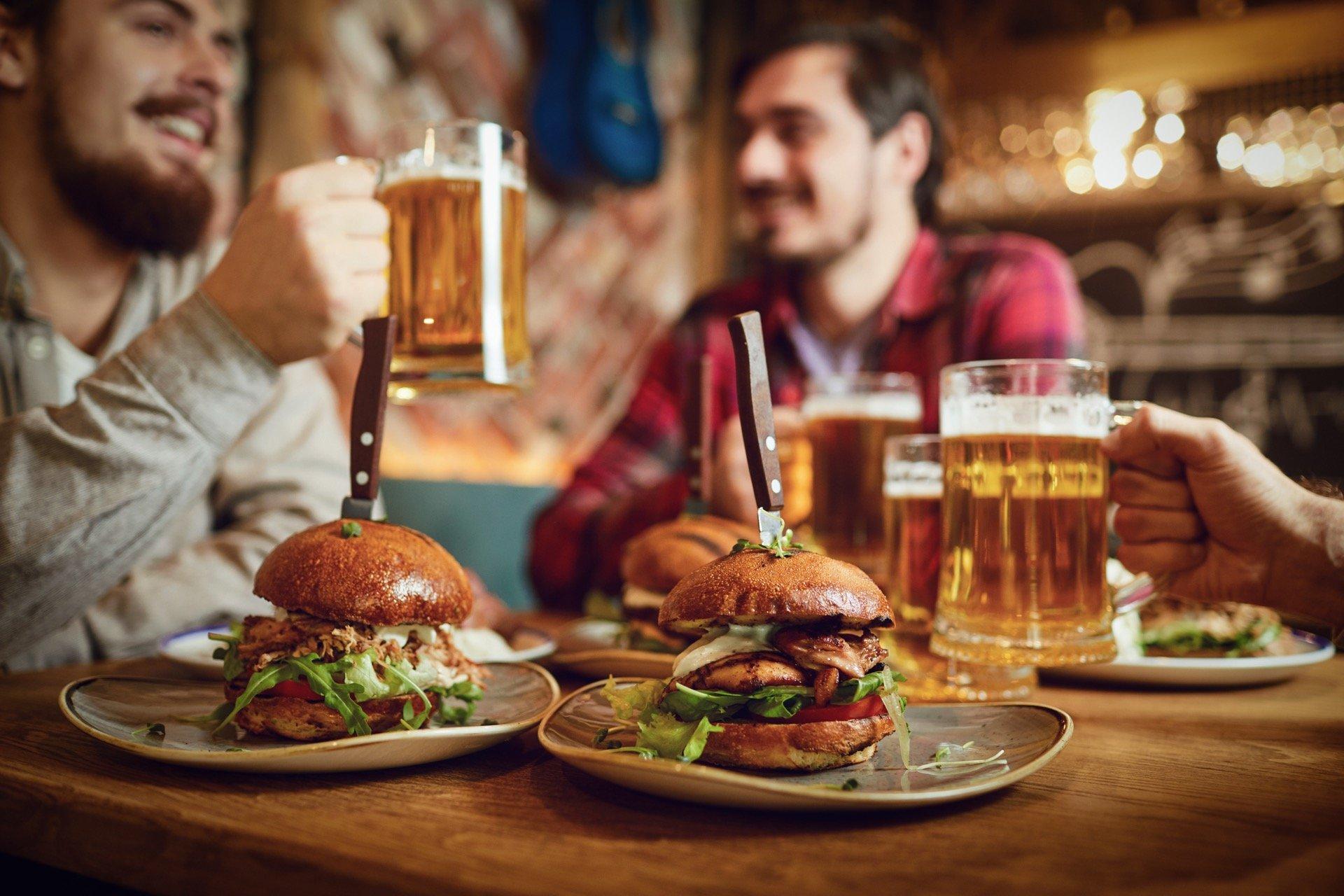 Young men enjoying burgers at Kelowna pub